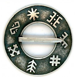 Latvian traditional brooch Sakta with runes
